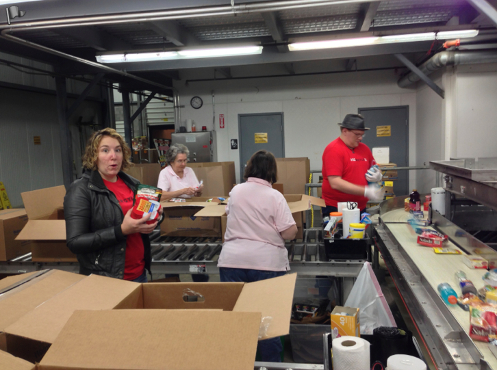 Mark and Lindsey sorting food in the Food Bank selection room